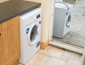 Push New Washing Machine into Place