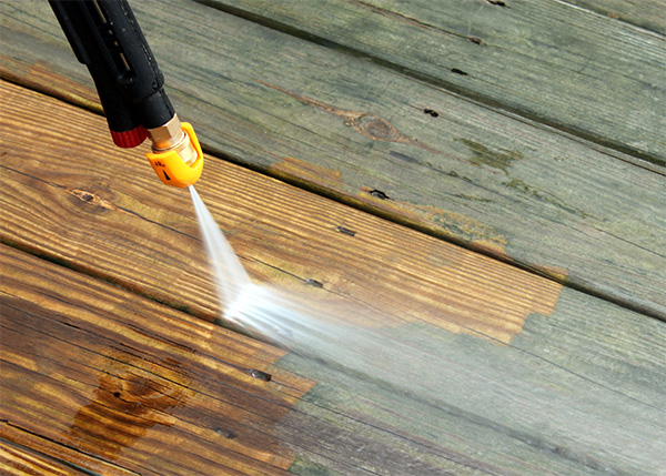 Pressure washing decking with pressure washer