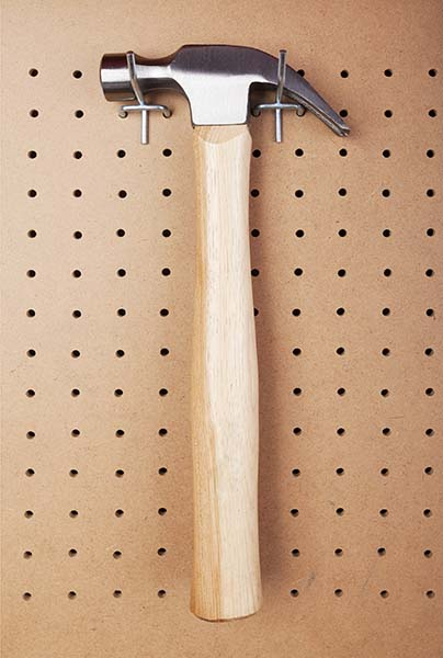 Hammer hanging on shed wall