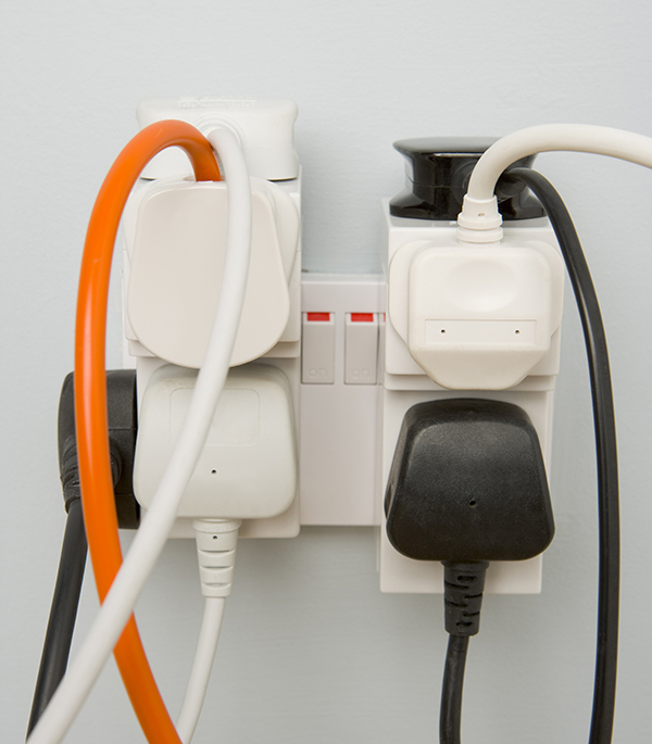 Overloaded electrical socket fire hazard