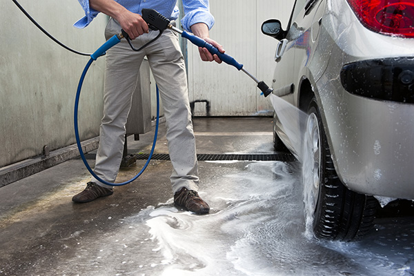Washing car with pressure washer