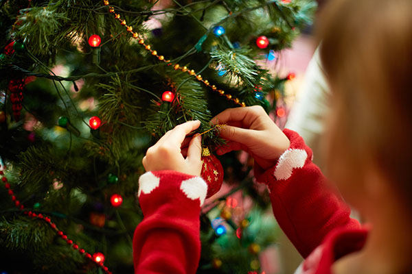 Decorating an artificial Christmas tree