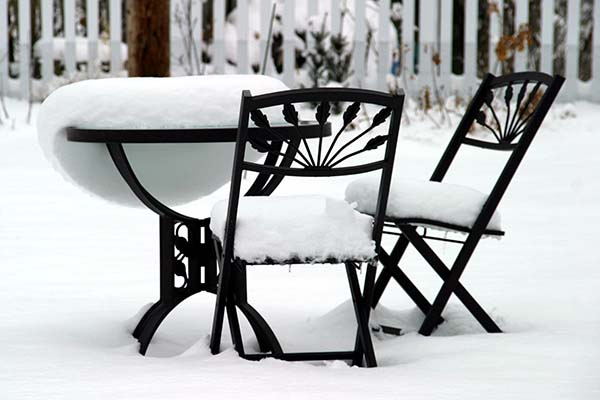 garden furniture in snow