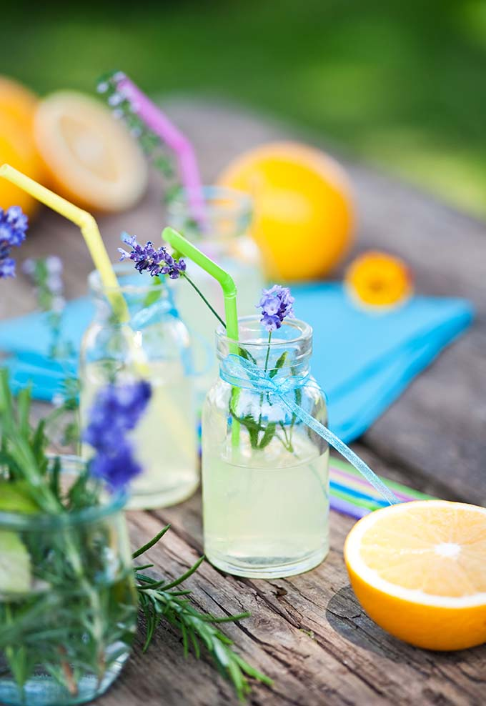 Lemonade in jars on wooden table at BBQ party